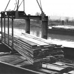 Off-loading timber from the River Lea into the Lebus storage and drying sheds