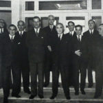 H.R.H. and the board of directors at the sports pavilion entrance - Desmond Stratton is second from the right